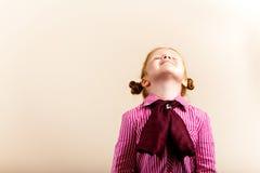 Portrait of cute elegant redhead girl looking up c Stock Photos
