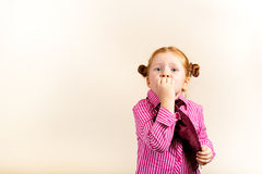 Portrait of cute elegant redhead girl mouth covere Royalty Free Stock Images