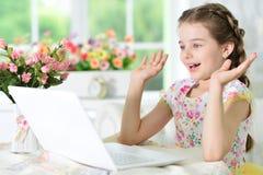 Little girl using laptop Stock Images