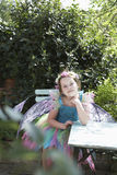Portrait Of Cute Fairy Girl At Garden Table Royalty Free Stock Images