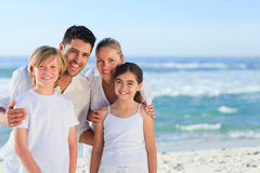 Portrait of a cute family at the beach Royalty Free Stock Photo