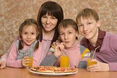 Portrait of a cute family Stock Photos