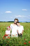 Portrait of cute family in poppy field Royalty Free Stock Photography
