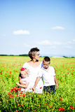 Portrait of cute family in poppy field Royalty Free Stock Photos
