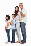 Portrait of a cute family in single file Royalty Free Stock Image