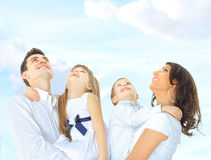 Portrait of a cute family on a sky background Stock Photo