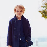 Portrait of cute fashionable boy in winter coat, outdoors Royalty Free Stock Images