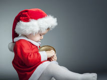 Child with santa cloths Stock Photos