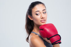 Portrait of a cute fitness woman with boxing gloves Stock Photos