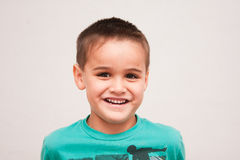 Portrait of cute four year old boy with short haircut Stock Photos