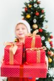 Funny little kid dressed in red night pajamas and hat of santa Royalty Free Stock Photos