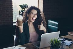 Portrait cute funny manager chief executive free time hold hand mug beverage satisfied recommend ad option advise decide. Excellent long curly wavy hair sit royalty free stock photo