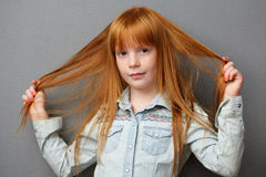 Portrait of a cute ginger girl Royalty Free Stock Photography