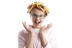 Portrait of a cute girl in a bathrobe and curlers. Stock Image