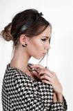 Portrait of cute girl in black and white houndstooth coat stock photo