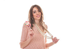 Portrait of cute girl with candy and bear toy Royalty Free Stock Photo