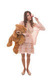 Portrait of cute girl with candy and bear toy. Portrait of cute lady with candy and bear toy Royalty Free Stock Image