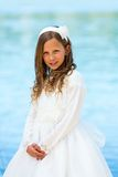 Portrait of cute girl in communion dress. Royalty Free Stock Photos