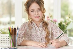 Girl drawing at home. Portrait of a cute girl drawing at home stock photos