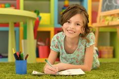 Girl drawing at home. Portrait of cute girl drawing at home royalty free stock images