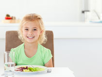 Portrait of a cute girl eating a healthy salad Royalty Free Stock Photo