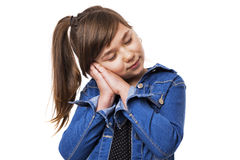 Portrait of a cute girl falling asleep Stock Images