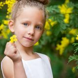 Portrait of Cute girl with flower outdoors. Stock Images