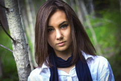 Portrait of a cute girl in the forest Royalty Free Stock Image