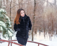Portrait of a cute girl fur coat. Stock Image