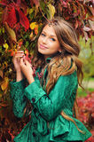 Portrait of a cute girl in green jacket. Stock Photos