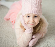 Portrait of cute girl in hat and gloves at Christmas time Royalty Free Stock Images