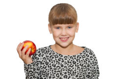 Portrait of cute girl holding an apple isolated Stock Images