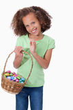 Portrait of a cute girl holding a basket full of Easter eggs Royalty Free Stock Photo