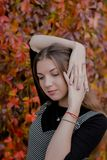 Portrait of cute girl holding her haed stock photos
