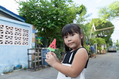 Portrait of a cute girl with ice cream  the outdoors. Portrait of a cute girl with ice cream on a walk in the park. child outdoors Stock Image
