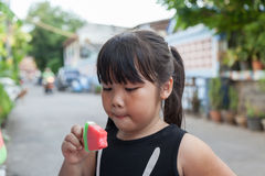 Portrait of a cute girl with ice cream  the outdoors. Royalty Free Stock Photography