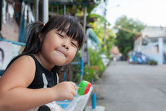 Portrait of a cute girl with ice cream  the outdoors. Royalty Free Stock Photo