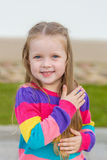 Portrait of a cute girl with long blond hair Royalty Free Stock Photos