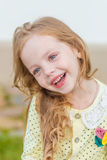 Portrait of a cute girl with long blond hair Royalty Free Stock Photography