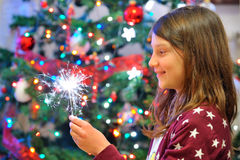 Portrait of cute girl looking at fire sparks. Royalty Free Stock Photography