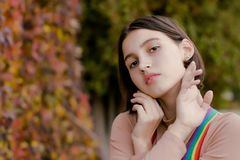 Portrait of a cute girl in multi-colored suspenders royalty free stock image