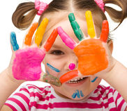 Portrait of a cute girl with painted hands Stock Photo