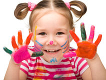 Portrait of a cute girl with painted hands Royalty Free Stock Image