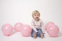 Portrait of cute girl with pink balloons. Having fun at the party Stock Photos