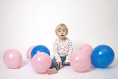 Portrait of cute girl with pink and blue balloons Royalty Free Stock Images