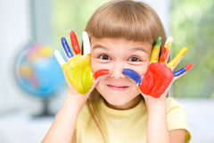 Portrait of a cute girl playing with paints Stock Images