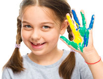 Portrait of a cute girl playing with paints Royalty Free Stock Image