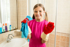 Portrait of cute girl in rubber gloves doing cleanup at bathroom Royalty Free Stock Photos