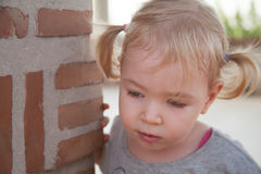 Portrait of cute girl with shocking face expression,  on brickwall Stock Photo