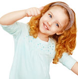 Portrait of cute girl showing thumbs up. Close up portrait of cute girl showing thumbs up, isolated Royalty Free Stock Photos